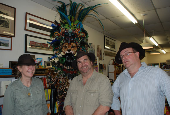 Pamela and Jon Voelkel stand with DDG owner Kenny Brechner, who helped arrange school visits for the authors in 2011.