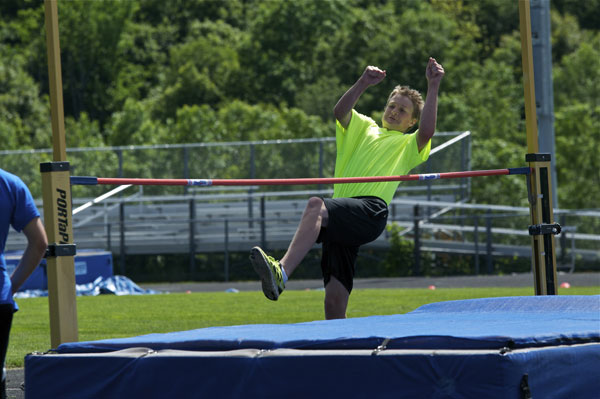 Miles Pelletier starts his attempt at high jump.