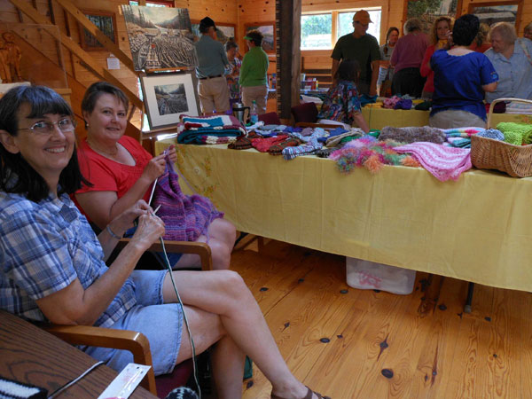 Holly LaPointe (left), Wilton, and Diane Schnellhammer, Rangeley, enjoy visiting and knitting together at the Rangeley Lakes Region Logging Museum's 2011 Knit and Crafts Show and Sale. This year's Show is Saturday 14 July, 9-3. Free admission. (Photo: Peggy Yocom)