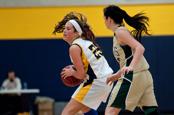 Gabby Foy (25) prepares to drive on Oxford Hills Abbie Eastman, Friday night, in a 49-30 win over the Vikings