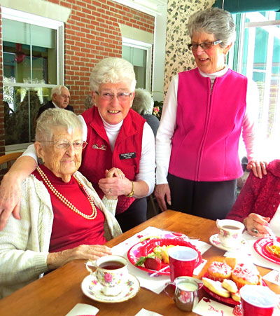 """Members of """"Friends of the Pierce"""" who always host all such fun occasions. Here celebrating with Leona Cross, 103, the oldest resident and former restaurant owner. (Photo by Jane Knox)"""