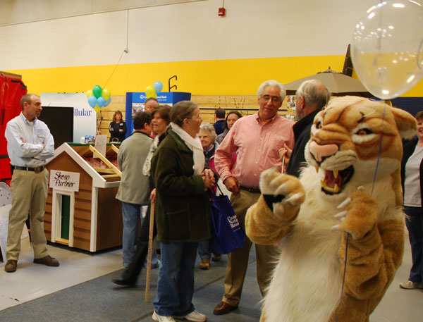 Mt. Blue's Cougar mascot make the rounds at the 19th annual Home & Leisure Show on Saturday.