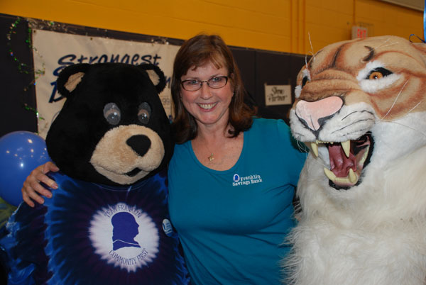 Anna Lyon of Franklin Savings Bank talks with a few friends of hers, FSB's Benjamin Black Bear and the Mt. Blue Cougar.