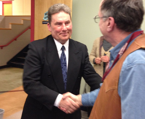 Dr. Thomas Ward is congratulated by RSU 9 school board director Robert Pullo of Wilton.