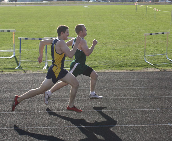 Mt.Blue's Zach Veayo pulls up from behind to beat Leavitt's Billy Clarke by 0.16 seconds in the 400 meters