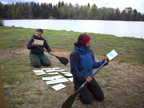 Emma Carlson, at left, and Emily Rooney read the students' postcards during a brief stop in Rangeley.