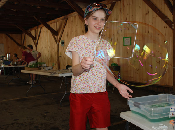 Natasha Essman, 12, of Wilton, successfully creates big bubbles at the 4-H Fair in Farmington on Saturday.