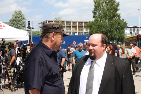 Selectman Ryan Morgan, right, is thanked by a resident for Franklin County's concern and the dispatch of 35 firefighters on the morning of the disaster.