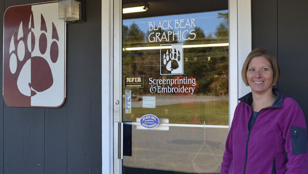 Amy Morin, co-owner of the Eastside Mall on Farmington Falls Road, stands at the door of Black Bear Graphics.