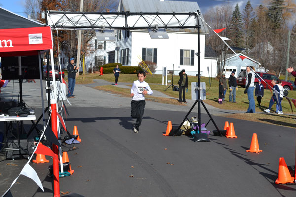 Jackson Joyce of Farmington finished first in the Turkey Trot's one mile Kid's Fun Run Saturday morning.