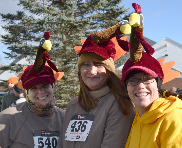 Race participants , from left to right: Jo Spielvogel, Gina Flagg and Nicole Sillik, got into the spirit of the Turkey Trot Saturday morning by wearing Matching hats.