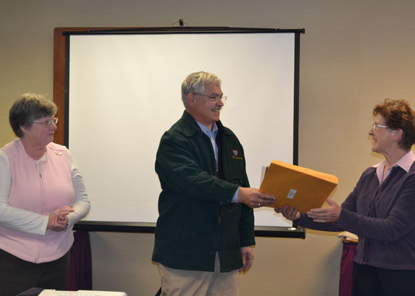 State Sen. Tom Saviello presents a legislative congratulations to Lois King, at left and Judy Smith of the Franklin County 4-H program.