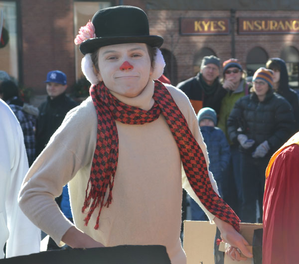 A cast member of Theatre UMF's Polar Express is a participant in the Chester Greeenwood Day parade on Saturday.