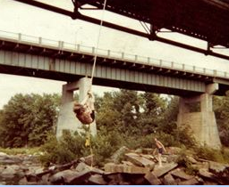 Swinging under the old iron bridge in New Sharon. (Photo courtesy of