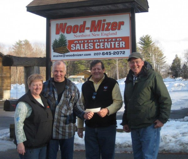 Wilton Fish & Game Assoc. Ice Fishing Derby committee members Bruce Dyke, second to the right, and Alan Hart, furthest to the right, receive a check from Maureen and Ross Clair, Authorized Sales and Service of Wood-Mizer, located in Chesterville.