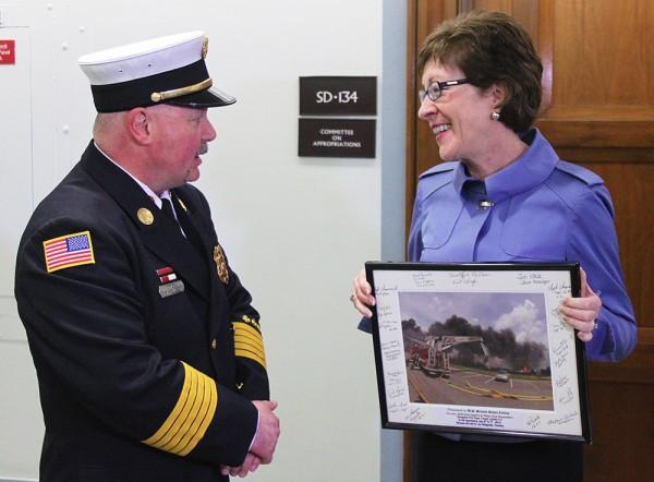 Rangeley Fire Chief Tim Pellerin presents  Maine Sen. Susan Collins