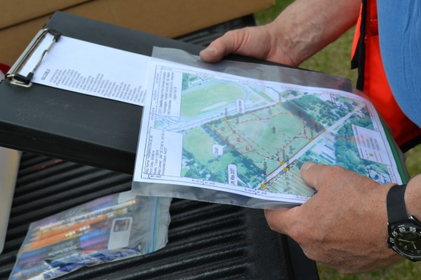 Pete Tracy, coordinator of the falg installation day in Farmington, looks at  map of the veterans' grave sites where American flags are to be placed on Sunday.