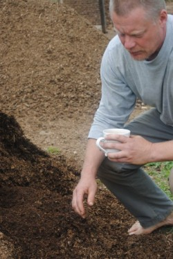 Farmer Robby Richards of Puckerbrush Farmin in New Sharon produces his own compost for growing crops he sells.