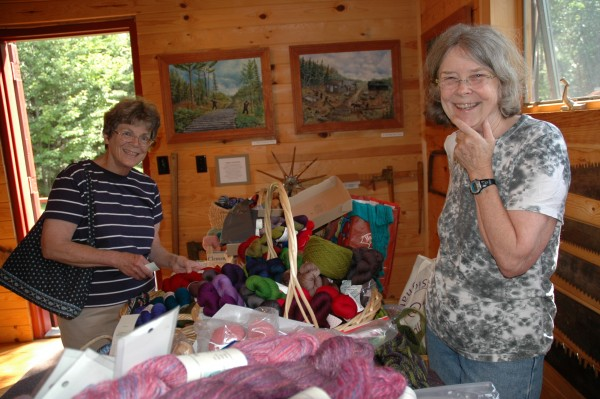Jan Soule, left, of Oquossoc picks out some of Barbara McEntee's specialty wool for sale at the Rangeley Logging Museum's Knit and Crafts Show, 2013. This year's event will be held on July 12, beginning at 10a.m. (Photo by Peggy Yocom)