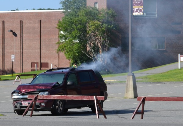 A smoke bomb simulates an explosive device in the Olsen Student Center parking lot.