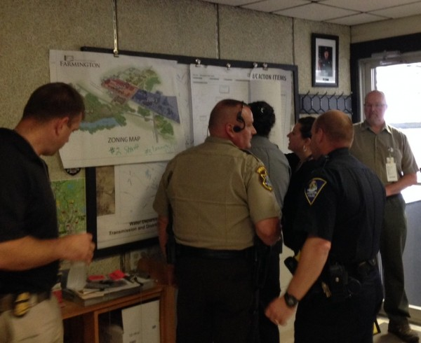 Officers at the incident command post in the fire station coordinate the response.