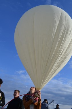 Mt. Blue High School student Brooke Bonnevie of Wilton, holds on to the balloon as it is inflated for flight.