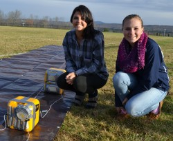 Mt. Blue 10th grade students Jordyn Lawrence and Kayla Kenney check their chia seeds as part of the payload at pre-launch.