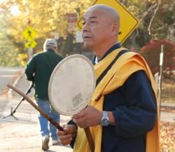 Brother Senji Kanaeda of the Buddhist Nipponzan Myohoji Temple in Seattle, leads the walk on Tuesday from Farmington.