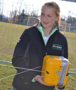 Spruce Mountain's Amber Delaney holds one of the payload boxes as the balloon is launched.