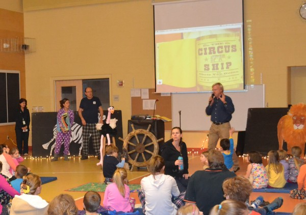 """Author/Illustrator Chris Van Dusen reads from his book """"The Circus Ship"""" at W.G. Mallett School's Prime Time Reading Event. To the left is Principal Tracy Williams, Librarian Amanda Roberts and Kenny Brechner of DDG Booksellers."""