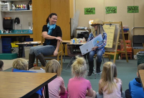 Author Lydia Schofield and mother Tiffany Schofield read 'Bendy-Wendy' to a group of kindergarteners at Cape Cod Hill School Friday morning.