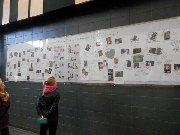 Pauline Lefeuvre viewing the photos of each victim with messages from family and friends. This was put up at the explosion site and then transported to Civic Center in downtown LM. (Photo by Linda Beck)