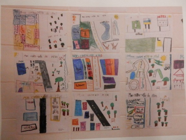 """These drawings were part of the participartory form of urban planning that LM has down thru """"Reinventer La Ville"""" (Reinvent the City), which is the topic of the book we gave the director. These drawings were done by children of the community as to how they would like to see their city """"reinvented"""". (Photo by Linda Beck)"""