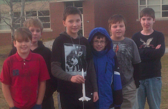 """This is Not Rocket Science"""" LEGO League Team preparing to lauch their model rocket and test their homemade altimeter. L to R:  Jordan Blanche, Isaac Pinard, Drew Delaney, Owen Wilkins, Dylan Gould, Caleb Blanche (not pictured Carter Mitchell, Hunter Quirrion, and Trevor Haynes)"""