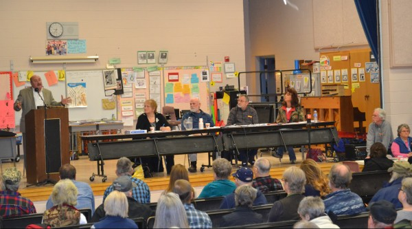 Left to right is Moderator Richard Thompson with Town Clerk Susan Anneley, Selectperson Maynard Webster, Selectperson Forrest Bonney and Selectperson Lorna Nichols.