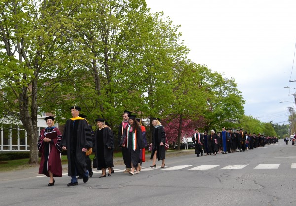 UMF President Kathryn A. Foster, faculty, administrators and dignitaries led the procession of 369 new graduates marching to traditional bagpipe music. UMF awarded a total of 392 bachelor's and master's degrees for 2015.