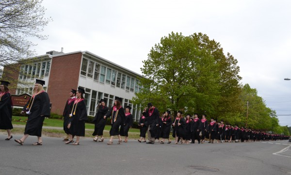 A procession of  University of Maine at Farmington's Class of 2015 march towards their commencement ceremony on Saturday in Farmington.