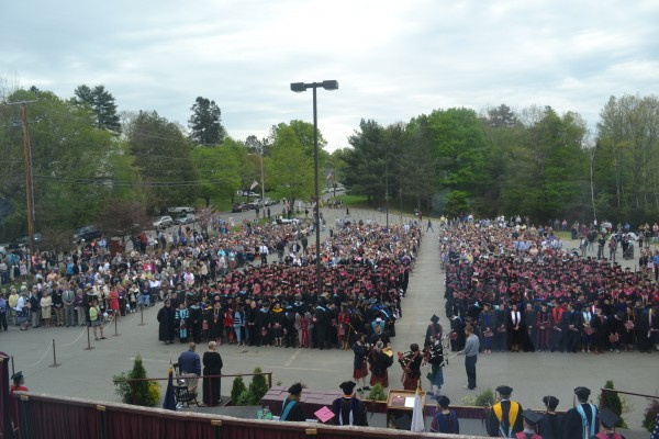 Hundreds of family and friends and the UMF graduating class of 2015 fill the parking lot on High Street on Saturday morning.