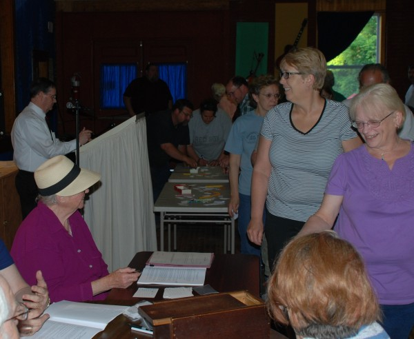 Town Clerk Evelyn Wilbur greets residents as they come up to vote Thursday evening.