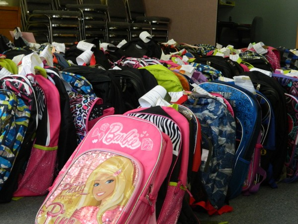 Backpacks ready for distribution.