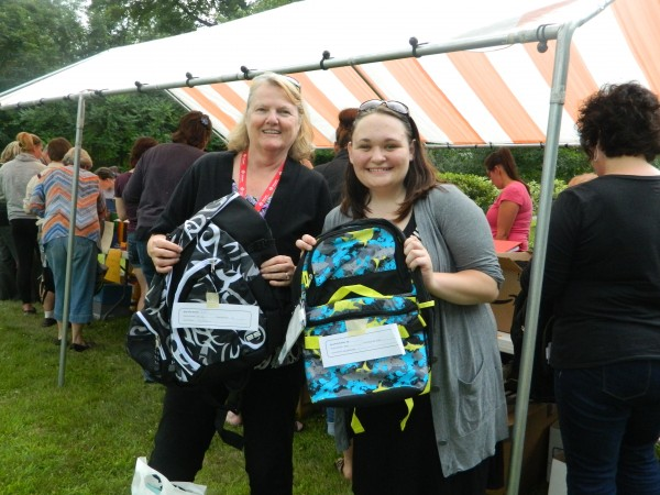Courtney Frost and Sharon Cullenberg, holding backpacks at today's event.