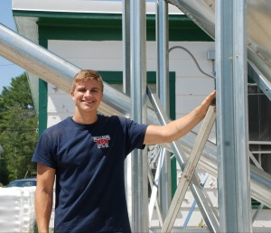 James Barker with the newly-installed silo for loose wood pellets. The company will be offering bulk delivery services in August.