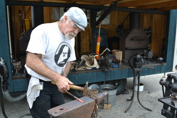 Stan Tilton of the Western Maine Blacksmithing Association demonstrates his trade at the Blueberry Festival Friday.