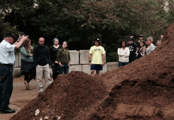 Professor Tom Eastler details the composting process to UMF students visiting the site.
