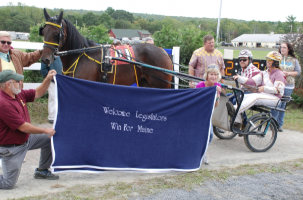 In the winners circle: Senate Majority Leader Garrett Mason, R-Androscoggin. Driver Charlene Cushing had something to do with Mason's success, as did race horse Shady Touch