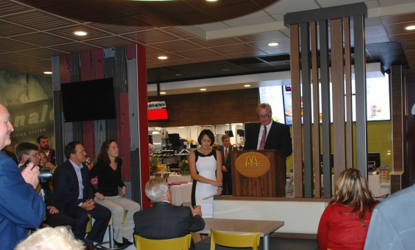 Larry Johnston, a senior area supervisor with the Napoli Group, speaks at the new McDonald's on Main Street Thursday evening.