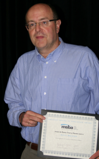 Kenny Brechner received the 2015 MSBA Business Friend of Education Award for his store's work in several local school district on Friday night.