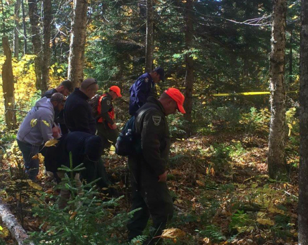 On Oct. 15, 2015 searchers walk in a line looking for Largey's remains.
