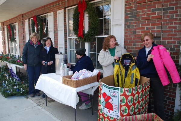 FSB staffers Diane Jackson, Jeannine McDonald, Kerstin Hand and Katrina Pease collect coats while Caitlyn Pease helps with the hot chocolate and popcorn at the 2013 Chester Greenwood Day parade.