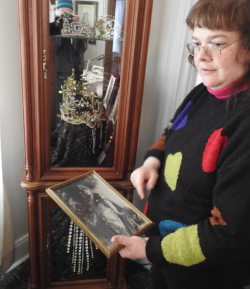 Jennifer Colby-Morse, who has worked extensively on inventory and digital recording the collection at The Norlands Living History Center in Livermore, shows a photograph of Lillian Nordica wearing the tiara in the glass display case at the museum.